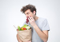 Handsome man holding a bag full of groceries Royalty Free Stock Photo