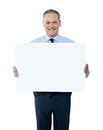 Handsome man holding blank white billboard Royalty Free Stock Images