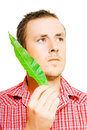 Handsome man holding a green leaf Royalty Free Stock Photo