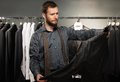 Handsome man with jacket beard choosing in a shop Royalty Free Stock Photography