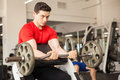 Handsome man lifting weights at the gym Royalty Free Stock Photo