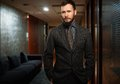Handsome man ln a hotel well dressed with beard in hallway Stock Photography