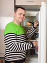 Handsome man looking for something in refrigerator Royalty Free Stock Photo