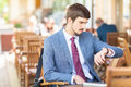 Handsome man looking time at watch Royalty Free Stock Photo