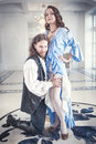 Handsome man in medieval costume seduces beautiful woman Royalty Free Stock Photo