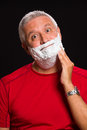 Handsome man middle age with shave cream on a black background Stock Image