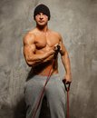 Handsome man with muscular body doing fitness exercise Stock Images
