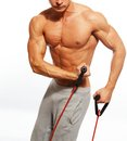 Handsome man with muscular body doing fitness exercise Royalty Free Stock Photo