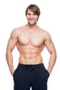 Handsome man with muscular torso portrait of a happy isolated on white background Stock Photography