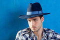 Handsome man with plaid shirt and cowboy hat Stock Images