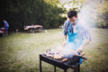 Handsome man preparing barbecue Royalty Free Stock Photo