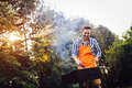 Handsome man preparing barbecue outdoors for friends Royalty Free Stock Photo