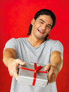 Handsome man presenting gift Stock Image