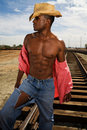 Handsome Man on Railroad Tracks Royalty Free Stock Photo
