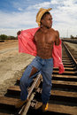 Handsome Man on Railroad Tracks Royalty Free Stock Image