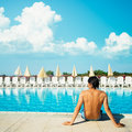 Handsome Man Relaxing near the Pool Outdoors Stock Photo