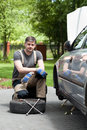 Handsome man repairing car outdoors portrait of a Royalty Free Stock Photo