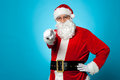 Handsome man in Santa costume pointing at you Royalty Free Stock Images