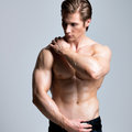 Handsome man with sexy muscular beautiful body posing at studio Stock Image