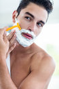 Handsome man shaving his beard Royalty Free Stock Photo