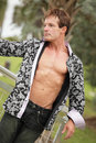 Handsome man with shirt unbuttoned Royalty Free Stock Photo