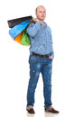 Handsome man with shopping bags on a white background Royalty Free Stock Photo