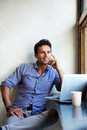 Handsome man sitting with laptop at cafe Royalty Free Stock Photo