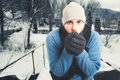 Handsome man sitting outside and freezing Royalty Free Stock Photo