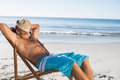 Handsome man sleeping on his deck chair Royalty Free Stock Photo