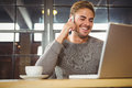 Handsome man smiling and phoning with smartphone Royalty Free Stock Photo