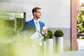 Handsome man standing near office building Royalty Free Stock Photo