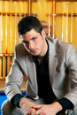 Handsome man with suit sitting in billiard pool Stock Image