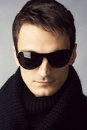 Handsome man in sunglasses and black scarf Royalty Free Stock Photography