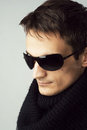 Handsome man in sunglasses and black scarf Royalty Free Stock Photo