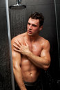 Handsome man taking the shower muscular Stock Photography