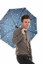Handsome man with an umbrella Stock Image