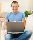 Handsome man using a laptop at home Royalty Free Stock Photo