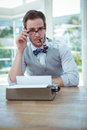 Handsome man using old fashioned typewriter Royalty Free Stock Photo
