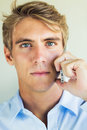 Handsome man using smart mobile phone young professional Stock Photography