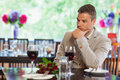 Handsome man waiting for his girlfriend at restaurant with a bouquet in a classy Stock Photos
