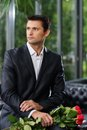 Handsome man waiting his lady in restaurant Royalty Free Stock Photo