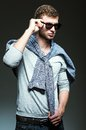 Handsome man wearing jeans shirt and sunglasses studio fashion shot young Royalty Free Stock Image