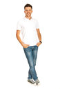 Handsome man in white t shirt young blank and jeans posing isolated on background Royalty Free Stock Photos