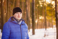 Handsome man in winter forest portrait of young cheerful outdoor Royalty Free Stock Photos