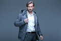 Handsome man in winter jacket Stock Image