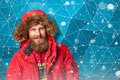 Handsome man in winter snow bearded wearing red jacket with hood over ice abstract background Stock Photography