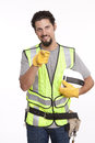 Handsome manual worker pointing towards camera portrait of a gesturing Royalty Free Stock Image
