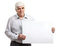 Handsome mature man holding a blank billboard isolated on white background Stock Photos