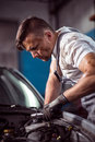Handsome mechanic working Royalty Free Stock Photo