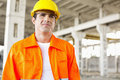 Handsome mid adult man wearing protective workwear at construction site Stock Image